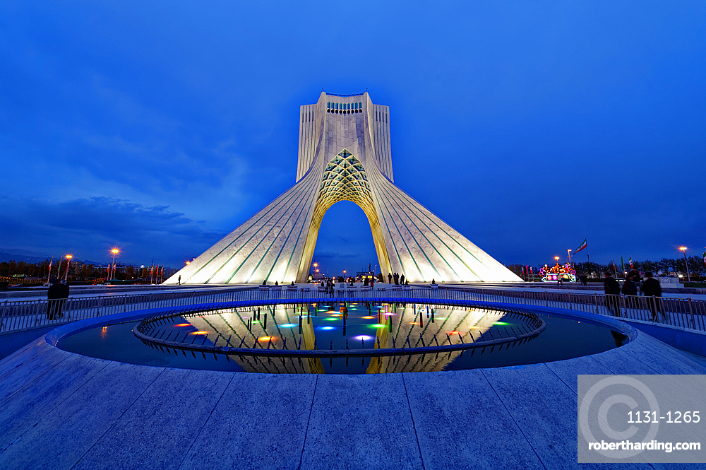 Azadi Tower (Freedom Monument) and cultural complex reflecting in a pond at sunset, Tehran, Islamic Republic of Iran, Middle East