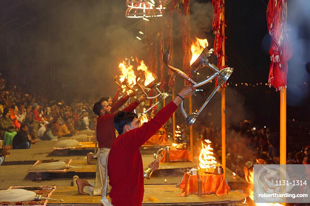 Priest celebrating the river Ganges Aarti by offering incense, Dashashwamedh Ghat, Varanasi, Uttar Pradesh, India