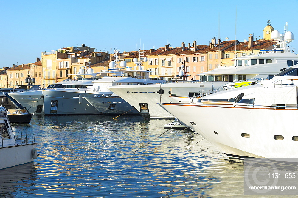 Luxurious motor yachts harboring in the marina of St.-Tropez, Var, Provence Alpes Cote d' Azur region, France, Europe