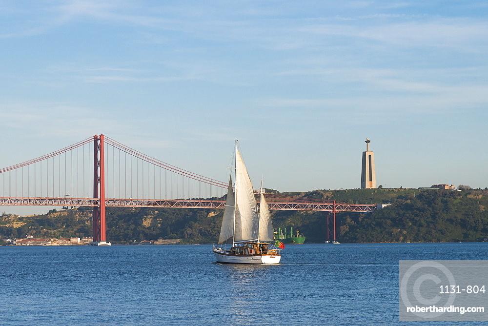 Sailboat navigating on the Tagus River near the Ponte 25 de Abril, Belem, Lisbon, Portugal, Europe
