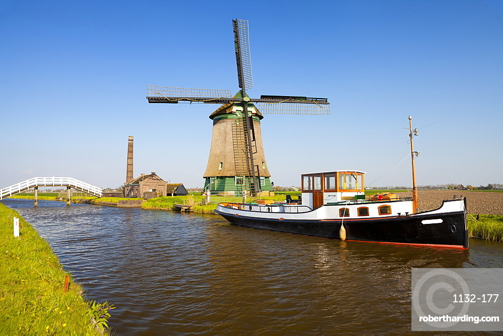 Traditional Windmill beside a Canal, near Obdam, North Holland, Netherlands, Europe
