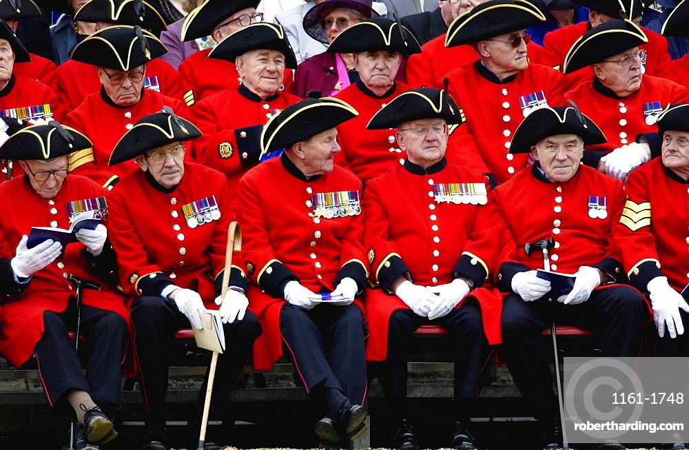 Chelsea Pensioners - the Corps of war veterans cared for at the Royal Hospital in Chelsea and known for their distinctive red uniforms and tricorn hats. They proudly display their medals won for valour.