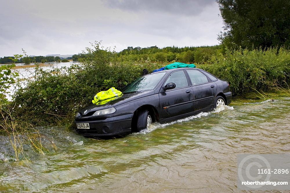 Car forced off the road by flooding in Lyneham, Oxfordshire, England, United Kingdom