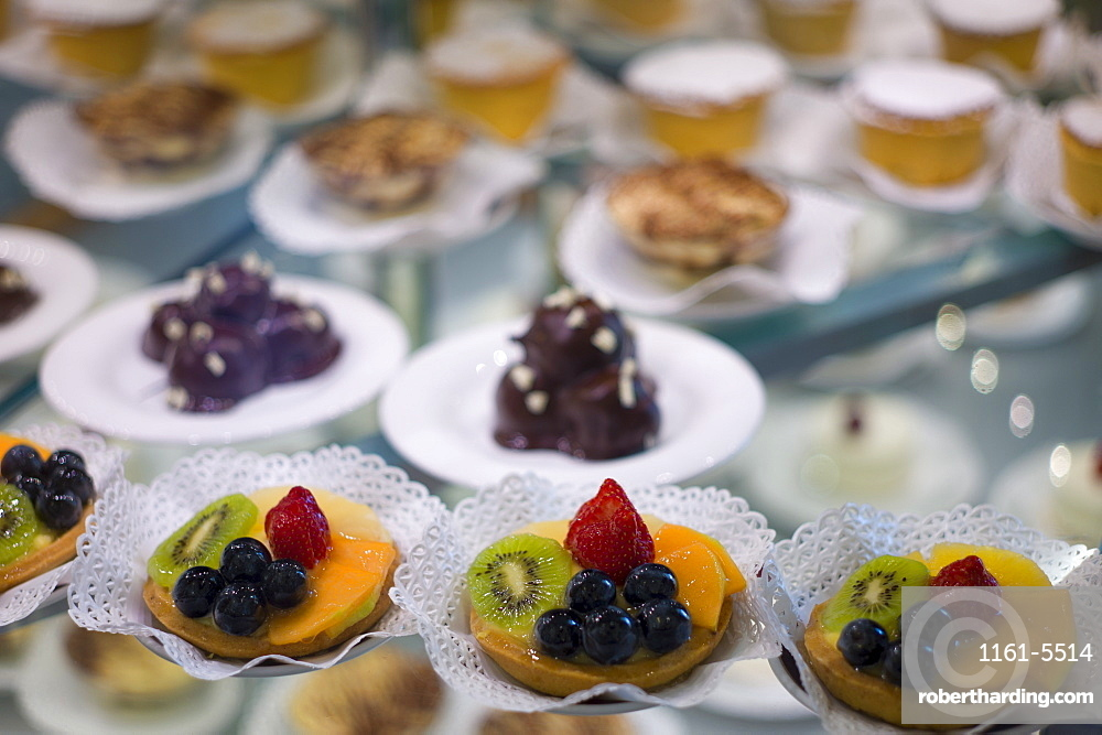 Cakes and pastries in shop window of luxury patticeria, caffe sweet shop Gilli  in Florence, Tuscany, Italy