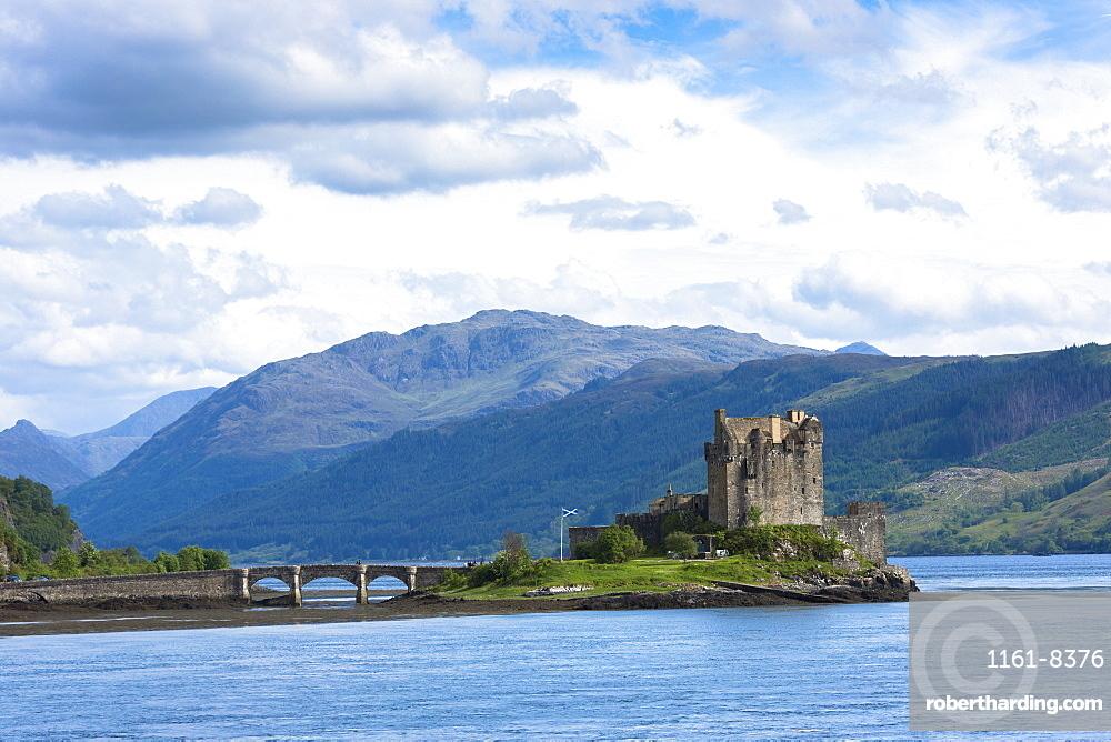 Eilean Donan Castle, a Highland fortress, with Saltire Scottish flag flying in Loch Alsh at Dornie, Kyle of Lochalsh in the western hIghlands of Scotland, United Kingdom, Europe