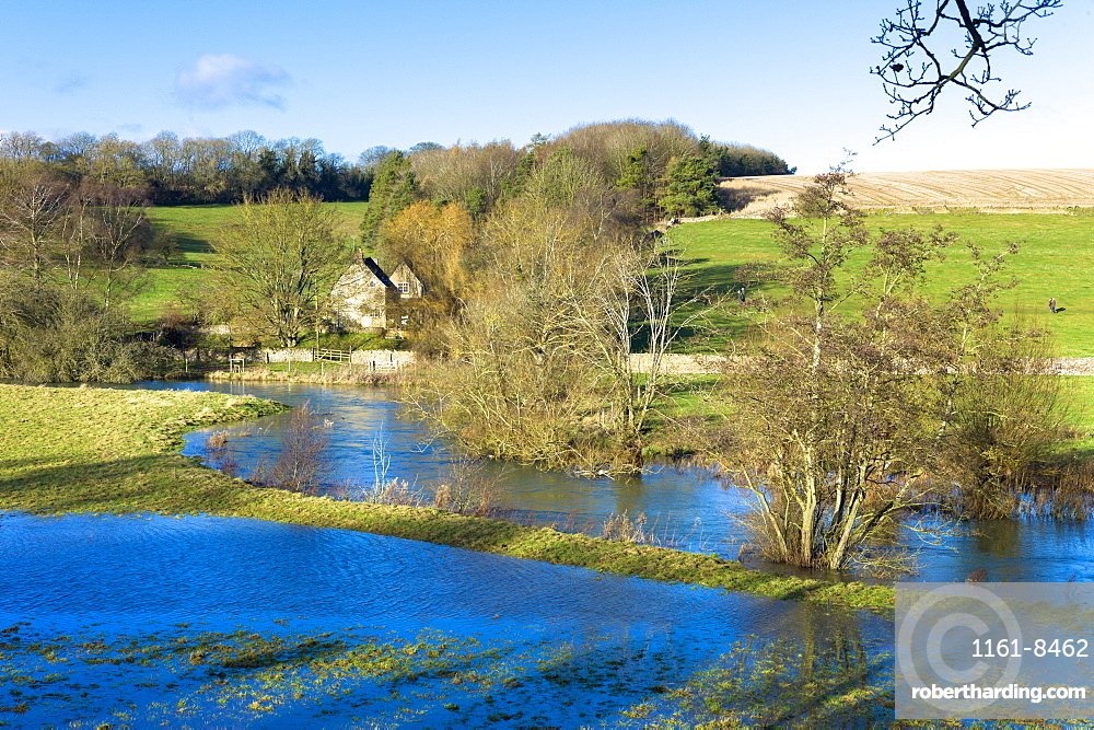 Flooded fields as the River Windrush burst its banks after heavy rain near Burford in The Cotswolds, Oxfordshire, England, United Kingdom, Europe