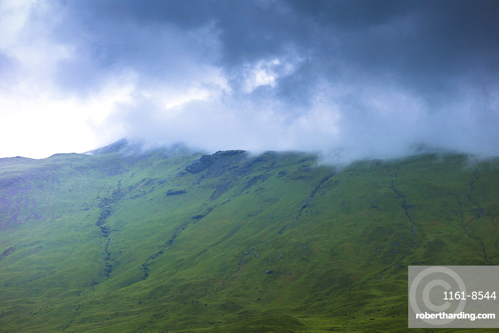 Low dark grey clouds tumbling over mountains on Isle of Mull, Inner Hebrides and Western Isles, Scotland, United Kingdom, Europe