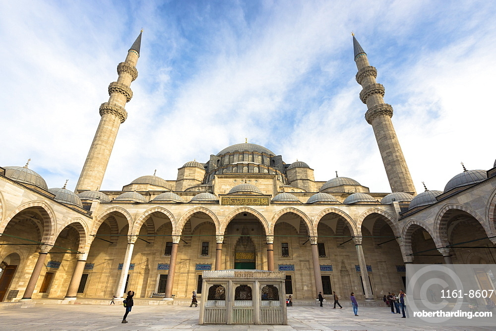 Tourists in colonnade courtyard of Suleymaniye Mosque, UNESCO World Heritage Site, Istanbul, Turkey, Europe