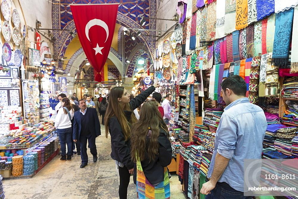 Young women tourists shopping in The Grand Bazaar, (Great Bazaar) (Kapali Carsi), Beyazi, Istanbul, Republic of Turkey, Europe