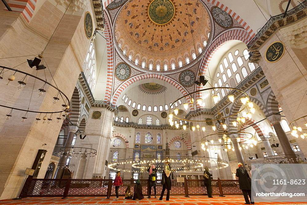 Tourists wearing scarves in Muslim tradition in interior of Suleymaniye Mosque, UNESCO World Heritage Site, Istanbul, Turkey, Europe