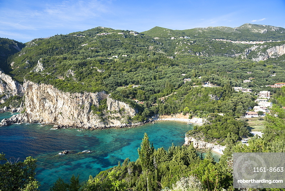 Paleokastritsa beach resort with cliffs and turquoise Ionian Sea in Corfu, Ionian Islands, Greek Islands, Greece, Europe