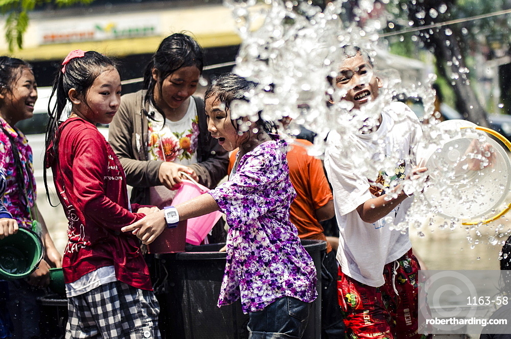 Locals celebrate Thai New Year by throwing water at one another, Songkran water festival, Chiang Mai, Thailand, Southeast Asia, Asia