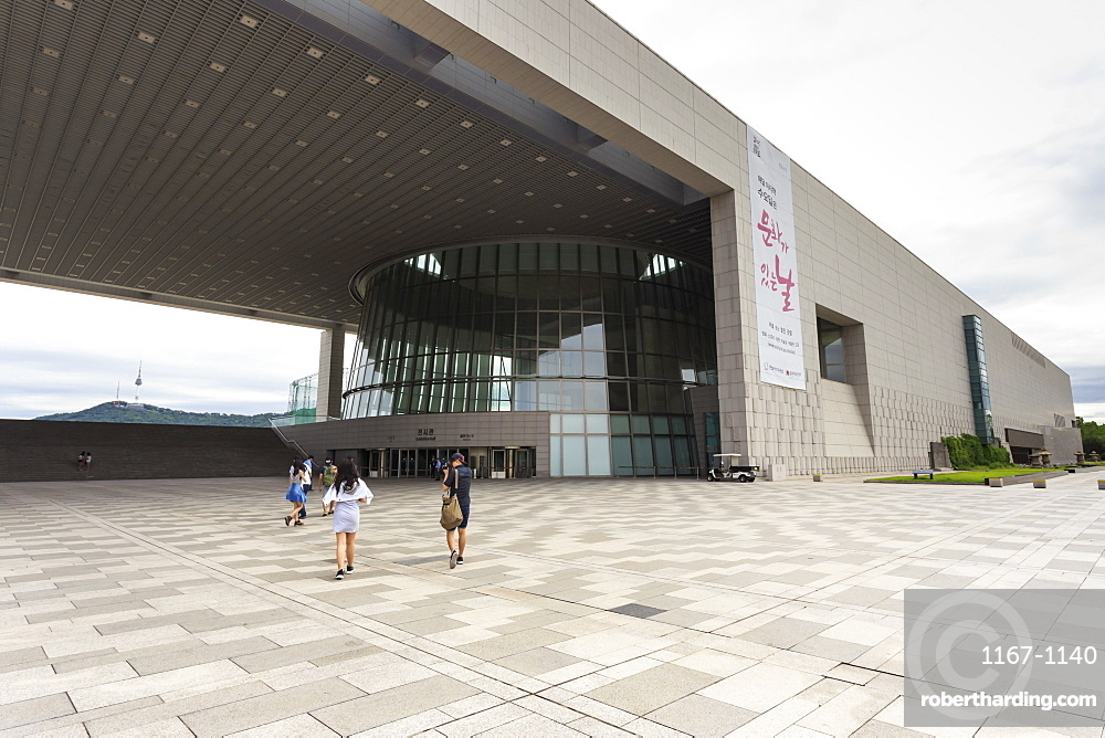 Visitors approach the Great Hall, National Museum of Korea, with distant N Seoul Tower, Yongsan-Gu, Seoul, South Korea, Asia