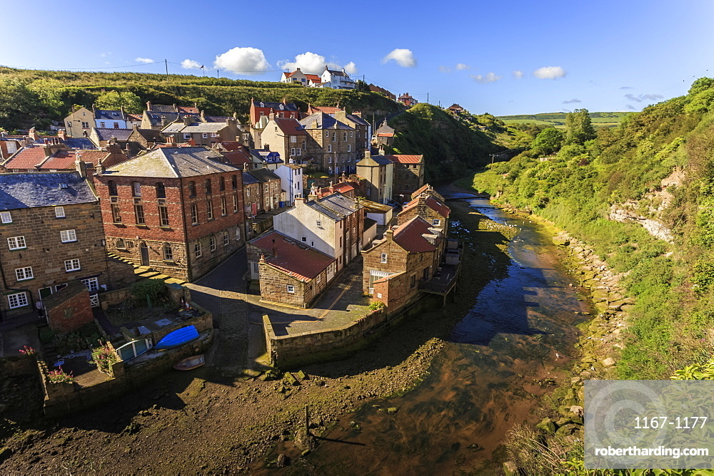 Steep streets of fishing village nd river, elevated view in summer, Staithes, North Yorkshire Moors National Park, Yorkshire, England, United Kingdom, Europe
