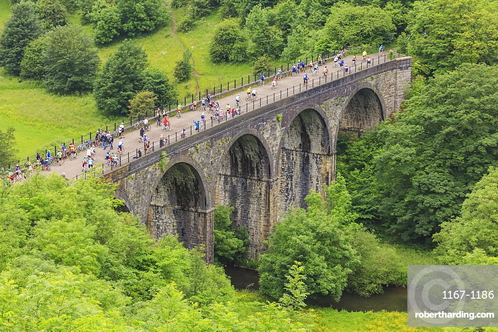 Monsal Trail, crowded with cyclists, former rail line viaduct over Monsal Dale at Monsal Head, Peak District, Derbyshire, England, United Kingdom, Europe