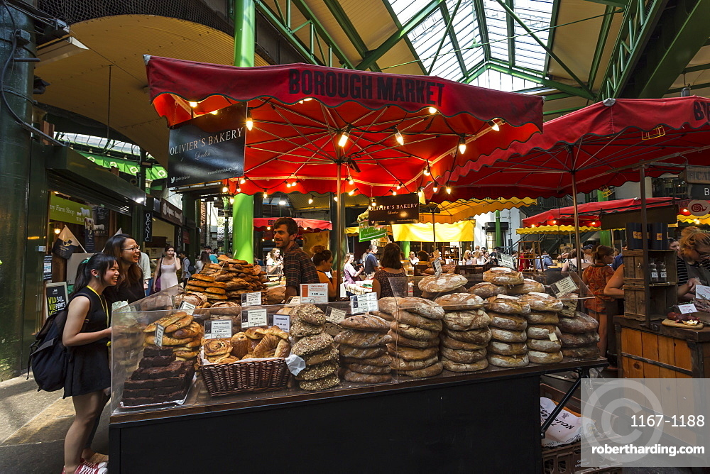 Customers at a bread stall, Borough Market, Britain's most renowned food market, Southwark, London, England, United Kingdom, Europe
