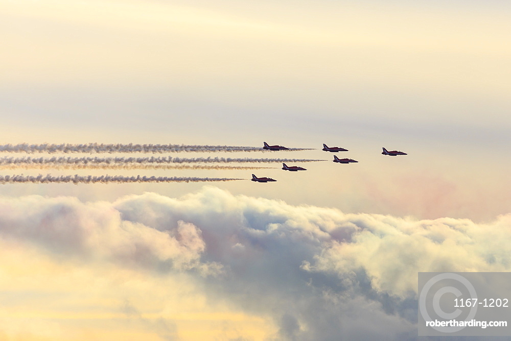 Red Arrows, Royal Air Force aerobatic display team, with colourful sky, England, United Kingdom, Europe
