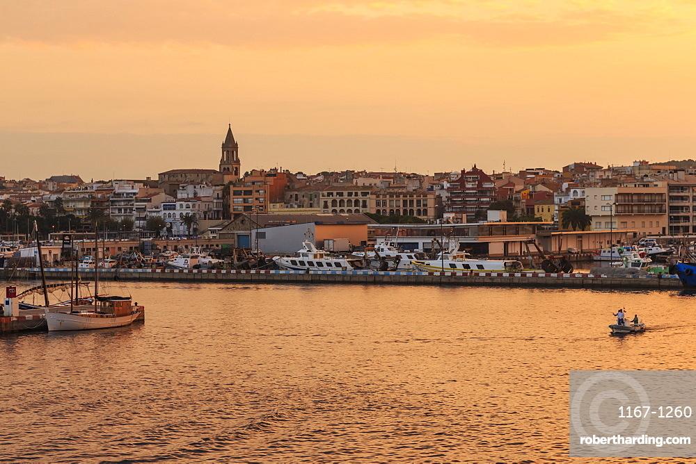 Fishing boats and town at sunrise, Palamos, Costa Brava, Girona, Catalonia, Spain, Europe