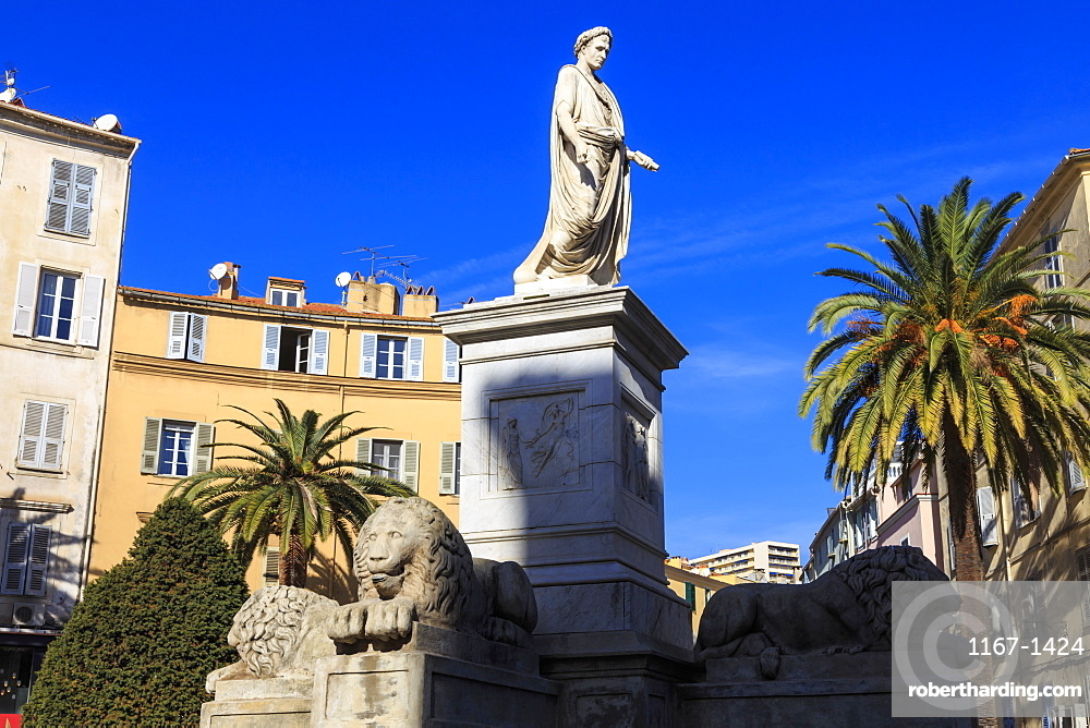 Statue of Napoleon as Roman Emperor, with lions and palm trees, pastel buildings, Place Foch, Ajaccio, Island of Corsica, France, Europe