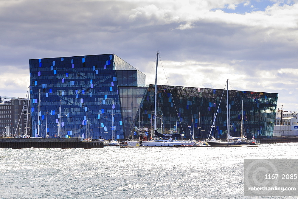 Harpa Conference and Concert Hall and yachts, from Thufa, green mound in summer, Reykjavik, Iceland, Polar Regions