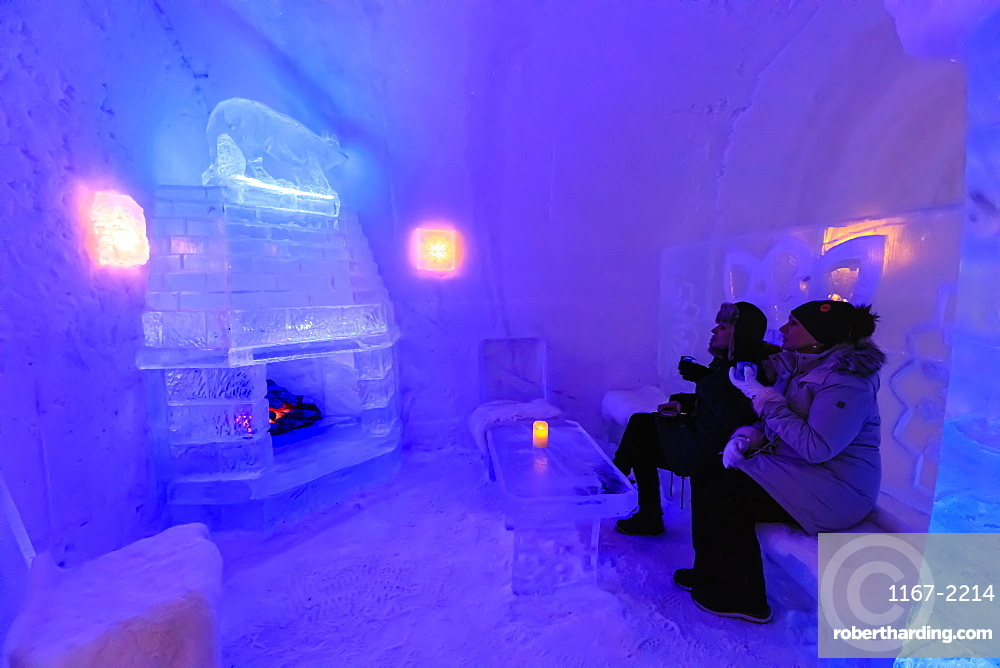 Sorrisniva Igloo Hotel, ice hotel, striking sculpture, cosy fire in ice bar in winter, Alta, Finnmark, Arctic Circle, Norway, Scandinavia, Europe