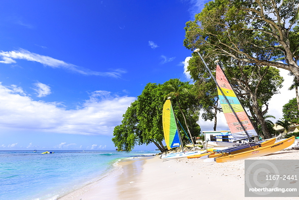 Paynes Bay, small colourful sail boats pulled up on fine sand beach, beautiful West Coast, Barbados, Windward Islands, West Indies, Caribbean, Central America