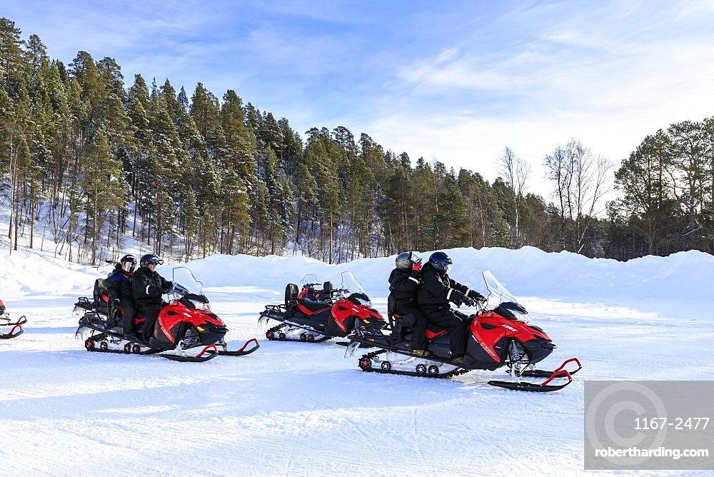 Snowmobile adventure, Alta Northern Lights tourists, Winter snow, sun, Troms og Finnmark, Arctic Circle, North Norway, Europe