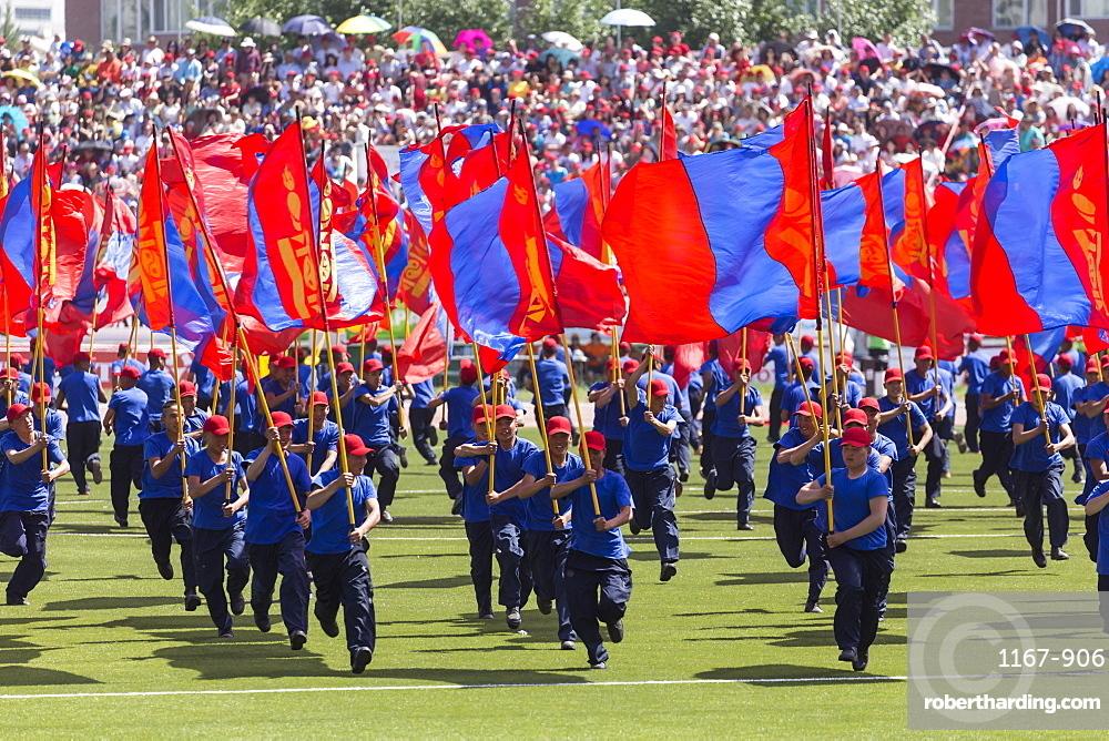 Young men run with Mongolian flags, Naadam Stadium, Naadam Festival Opening Ceremony, Ulaan Baatar (Ulan Bator), Mongolia, Central Aisa, Asia