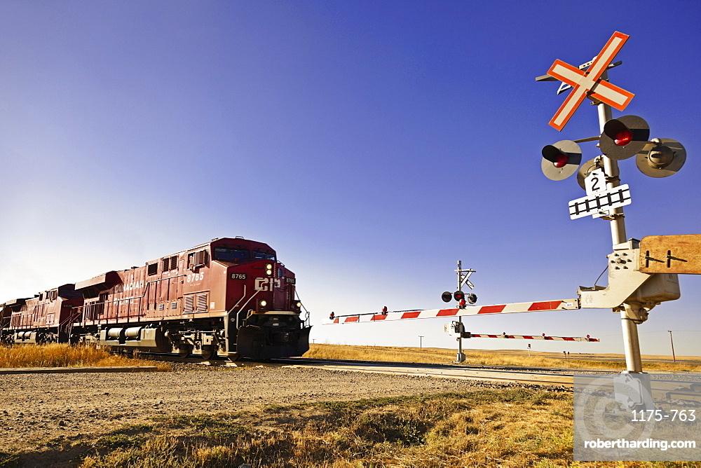Railway crossing line at Highway 1 west to Alberta, Saskatchewan, Canada