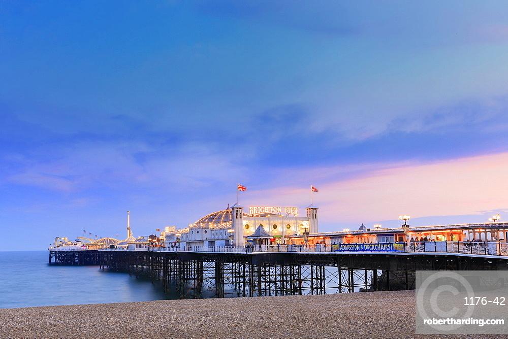 The Palace Pier (Brighton Pier) at dusk, Brighton, East Sussex, England, United Kingdom, Europe