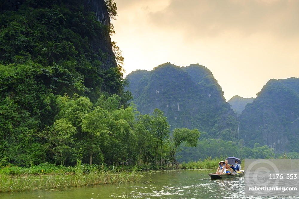 Boats in the karst landscapes of Tam Coc and Trang An in the Red River area , UNESCO World Heritage Site, Ninh Binh, Vietnam, Indochina, Southeast Asia, Asia
