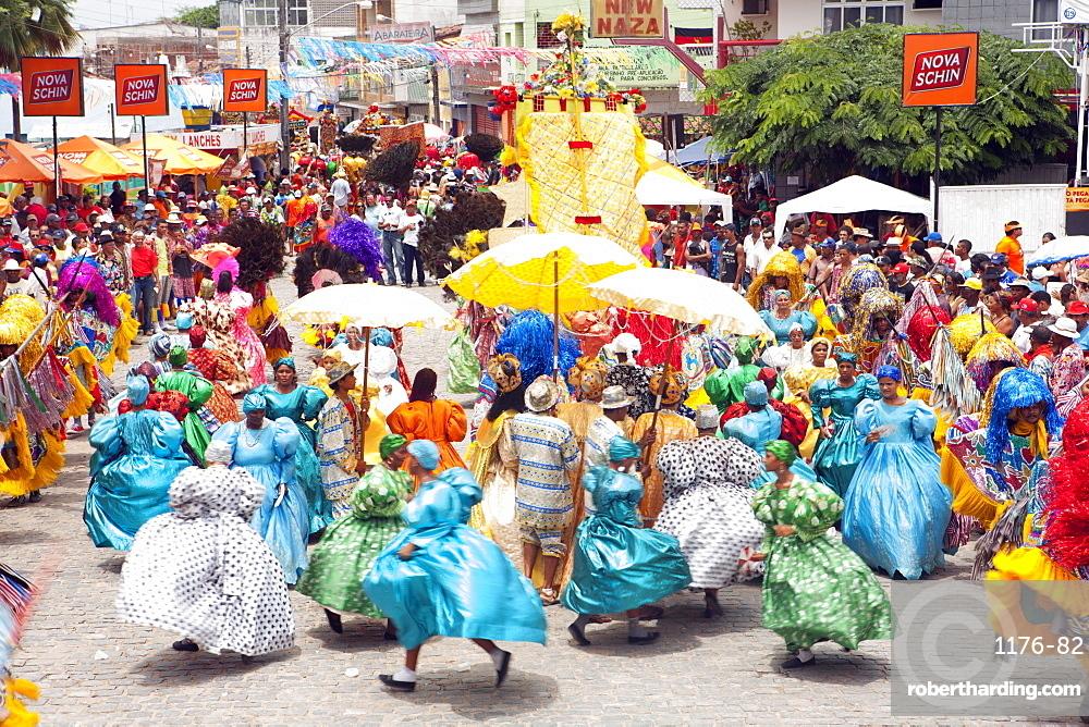 Locals dancing at a Maracatu parade at Carnival, Nazare da Mata, Pernambuco, Brazil, South America