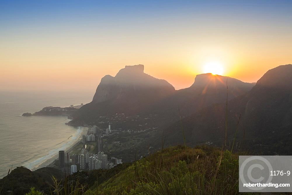 Sunset over Pedra da Gavea mountain (Gavea Rock), with the neighbourhood of Sao Conrado in foreground, Rio de Janeiro, Brazil, South America