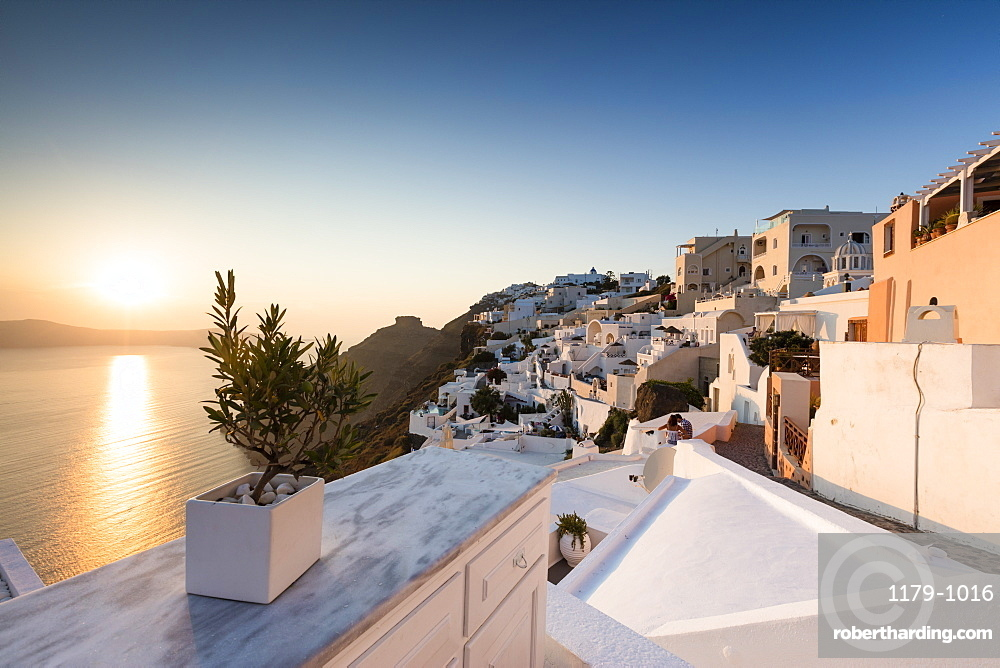 Sunset over the Aegean Sea seen from a terrace of the typical Greek village of Firostefani, Santorini, Cyclades, Greek Islands, Greece, Europe