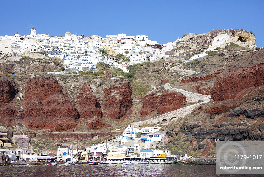 Typical Greek village perched on volcanic rock with white and blue houses and windmills, Santorini, Cyclades, Greek Islands, Greece, Europe
