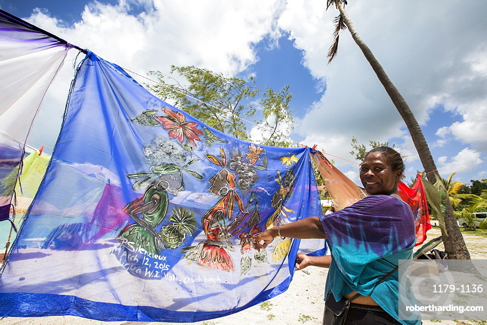Woman smiling showing the typical colors of the island, The Nest, Antigua, Antigua and Barbuda, Leeward Islands, West Indies, Caribbean, Central America