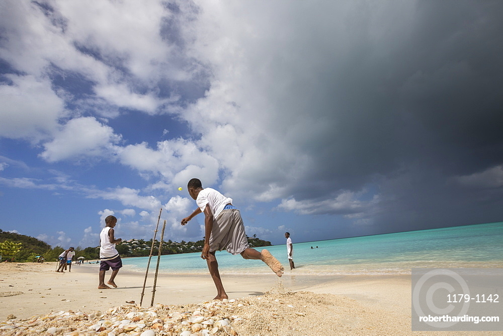 Kids playing on the beach surrounded by the turquoise Caribbean sea, The Nest, Antigua, Antigua and Barbuda, Leeward Islands, West Indies, Caribbean, Central America