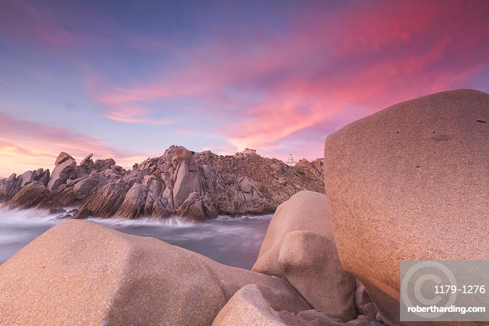 Pink sky at sunset frames the lighthouse on cliffs, Capo Testa, Santa Teresa di Gallura, Province of Sassari, Sardinia, Italy, Mediterranean, Europe