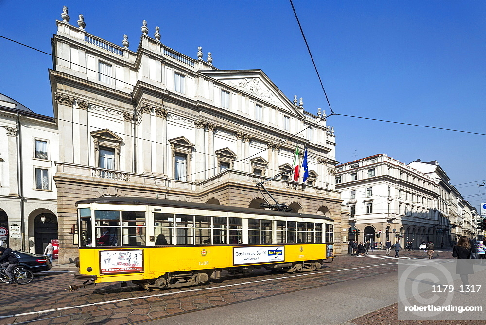The old tram frames the Teatro Alla Scala (La Scala), icon of Milan, Lombardy, Italy, Europe
