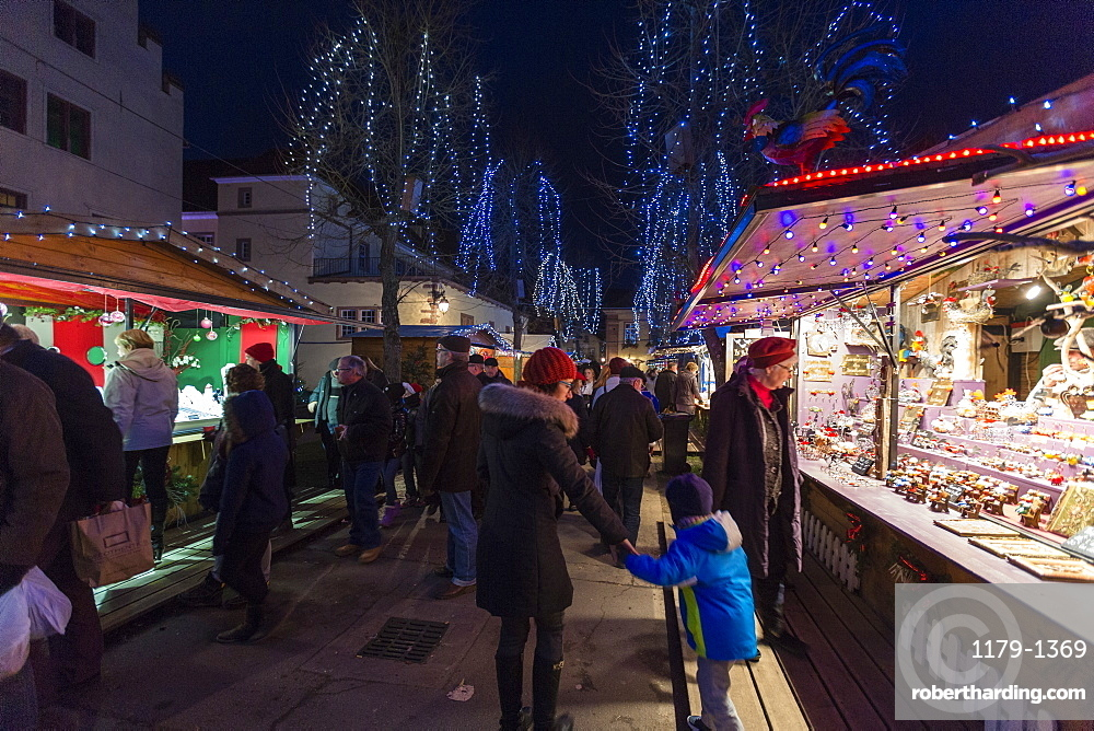 Tourists and Christmas Markets in the old medieval town of Riquewihr, Haut-Rhin department, Alsace, France, Europe