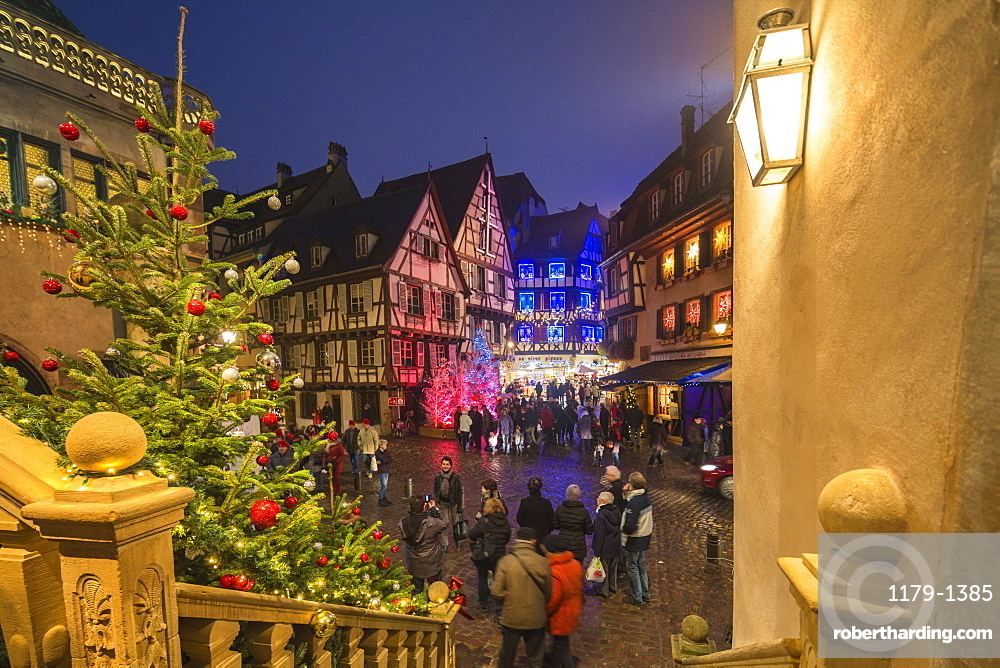 Christmas Markets in the old medieval town enriched by colourful lights, Colmar, Haut-Rhin department, Alsace, France, Europe