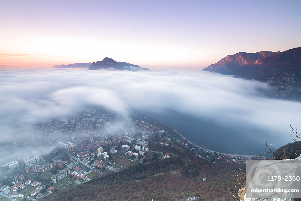 Fog at sunrise above the city of Lecco seen from Monte San Martino, Province of Lecco, Lombardy, Italy, Europe