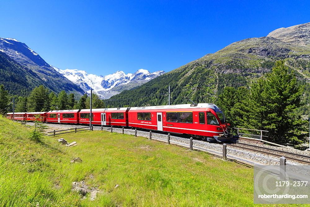 The Bernina Express train at Morteratsch in summer, Engadine, Canton of Graubunden, Switzerland, Europe