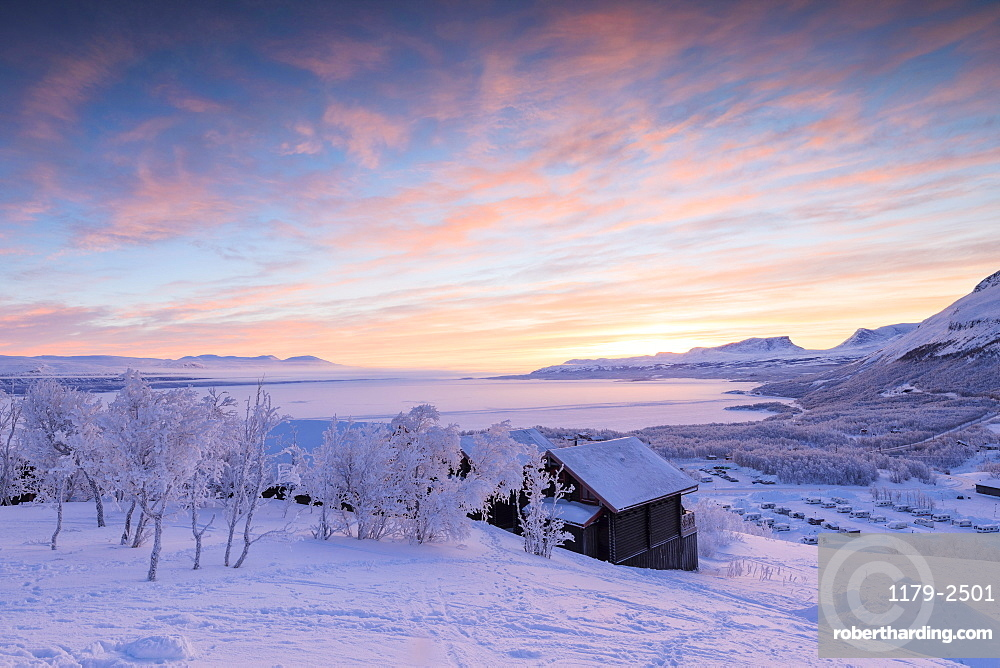 Pink sunrise on the snowy landscape, Bjorkliden, Abisko, Kiruna Municipality, Norrbotten County, Lapland, Sweden, Scandinavia, Europe