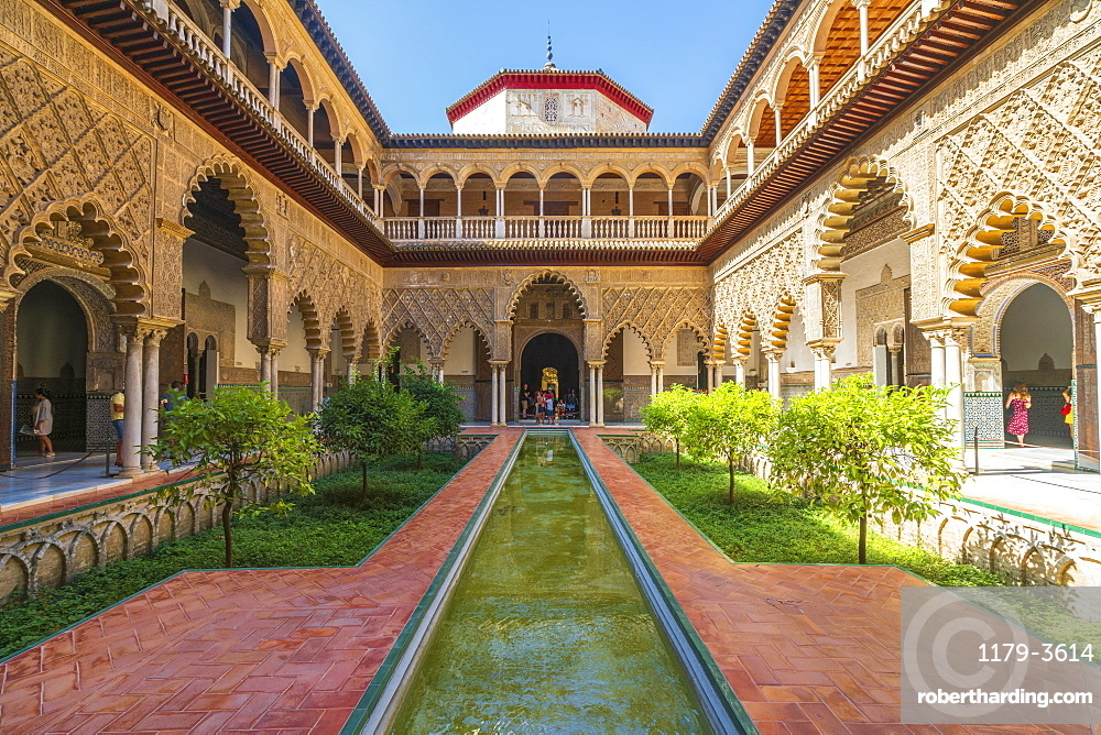 Patio de las Doncellas, a decorated courtyard and pool in typical Mudejar architecture, Real Alcazar, UNESCO World Heritage Site, Seville, Andalusia, Spain, Europe