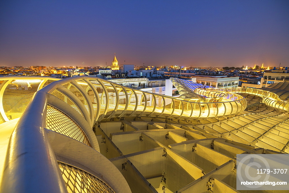 Illuminated spiral curved walkways on rooftop of the Metropol Parasol, Plaza de la Encarnacion, Seville, Andalusia, Spain, Europe