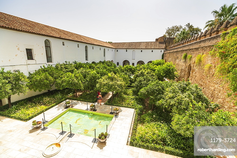 Tourists in the courtyard surrounded by defensive wall of fortress, Alcazar de los Reyes Cristianos, Cordoba, UNESCO World Heritage Site, Andalusia, Spain, Europe