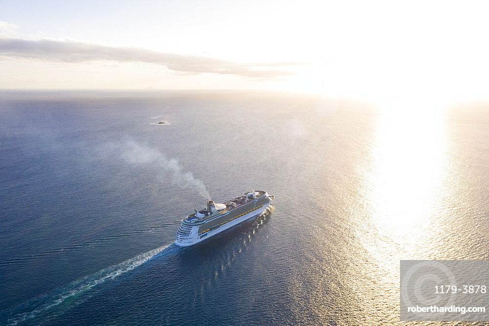 Cruise ship sailing in the Caribbean Sea at sunset, aerial view by drone, Antilles, West Indies, Caribbean, Central America
