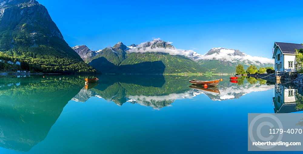 Panoramic of mountains reflected in the clear water of Oppstrynsvatn lake, Hjelle, Oppstryn, Sogn og Fjordane county, Norway