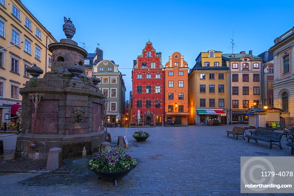 Dusk over the colorful facades of townhouses in the medieval Stortorget Square, Gamla Stan, Stockholm, Sweden